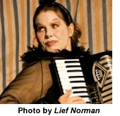Headshot of Debbie Patterson playing an accordion