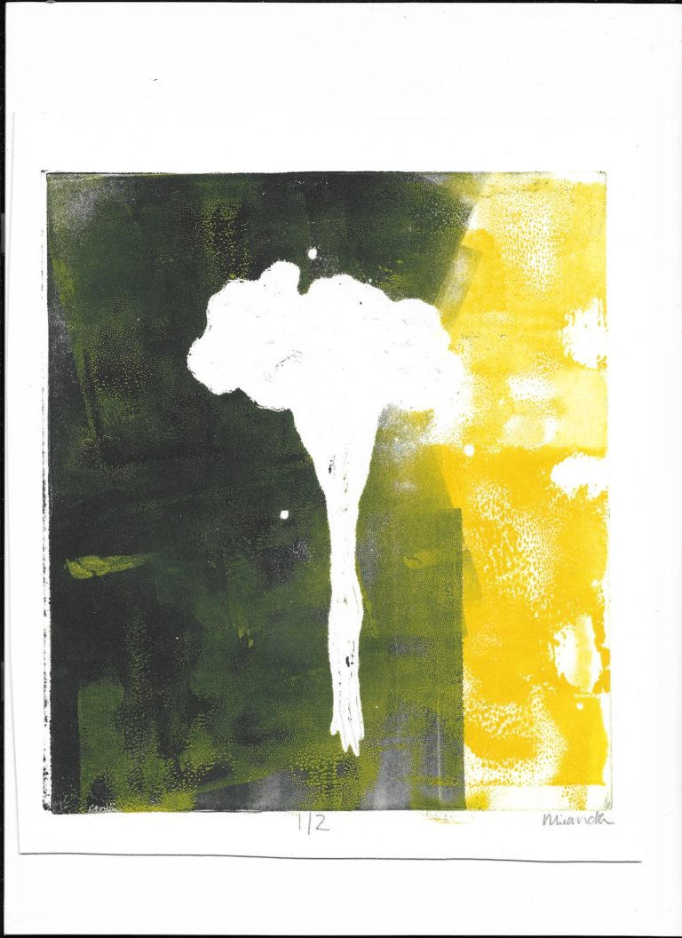 Image of a white atomic like explosion with black and yellow of either side.
