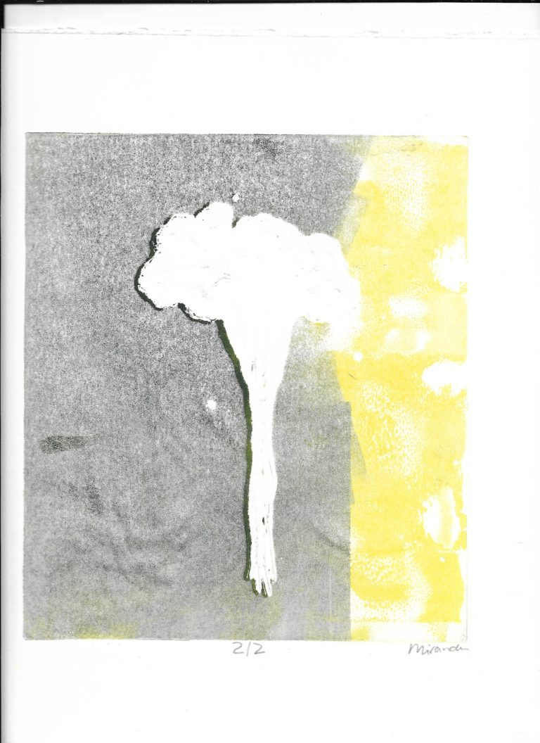 Image of a white atomic like explosion with grey and yellow of either side.