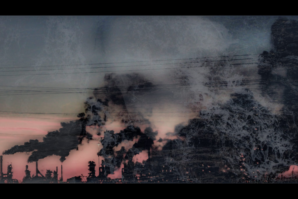 Blurry image of Marie's face superimposed over pollution from buildings. The image is red, grey and black.