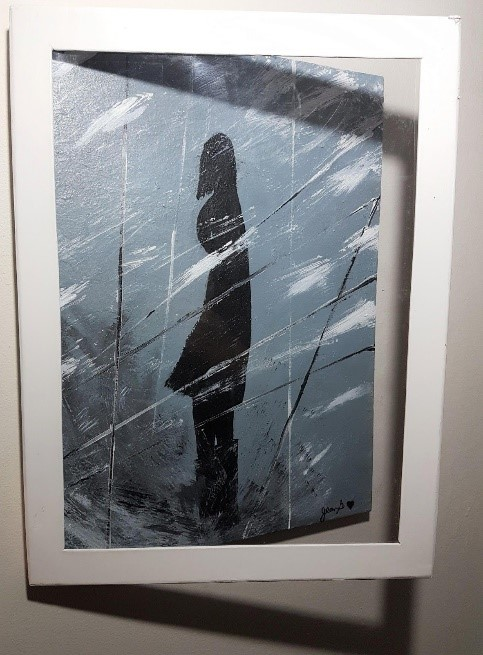 Silhouette of a woman in a winter storm