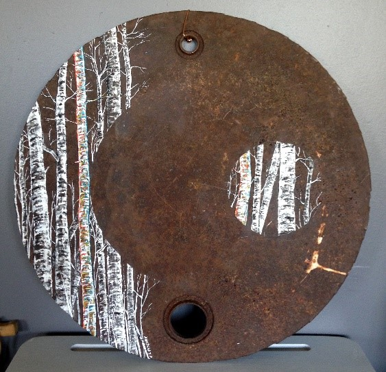 a rusty oil drum lid with a painting of birch trees on it