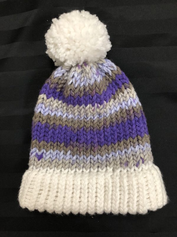 Image of a purple, grey and white knit hat