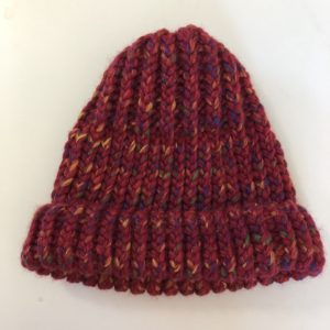 Image of a multi hued red knit hat