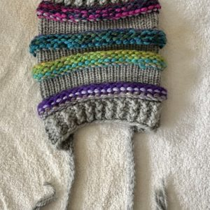 Image of a slouchy multi coloured and grey knit hat