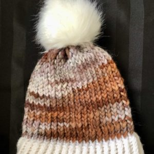 Image of a brown and white knit hat