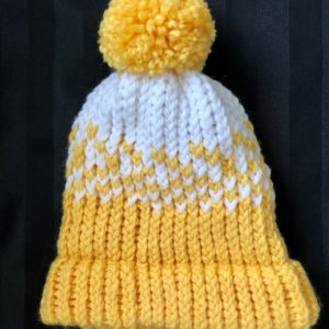 Image of a Yellow and white knit hat