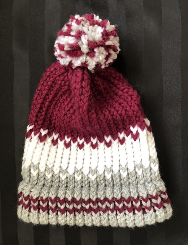 Image of a Burgundy, white and grey knitted hat