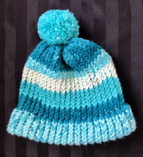 Image of a Turquoise hued knit hat