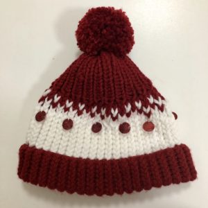 Image of a dark red and white knit hat