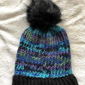 Image of a Peacock colours and black knit hat