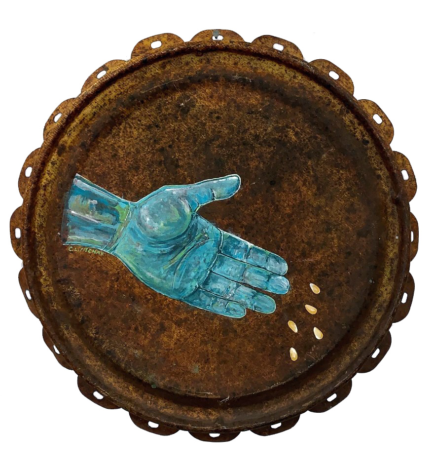 Rusted antique oil drum lid with an openhand painted in the middle with green and blue paint. There are five corn kernels that the hand has released.