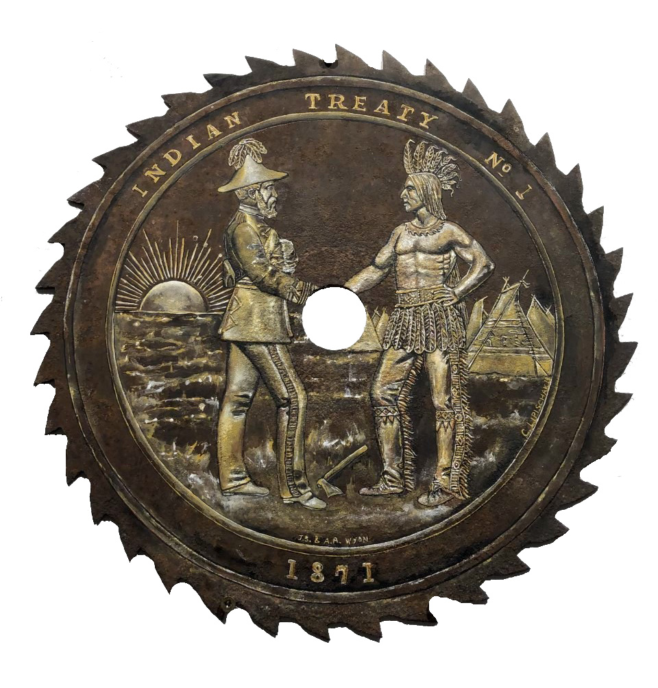 Antique saw blade with a scene painted in gold, yellow and white. The background of the image is a field with the sun setting on the left side. On the right are teepees. A colonial man in a regiment outfit with a hat with feathers, shakes hands with an indigenous man wearing a headdress, leather pants and belt with feathers on it. The center of the saw blade has a hole missing where the two are shaking hands. Between the two men is an axe in the ground.